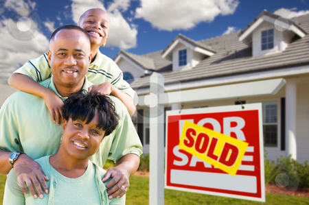 cutcaster-photo-100684358-African-American-Family-with-Sold-For-Sale-Sign-and-House
